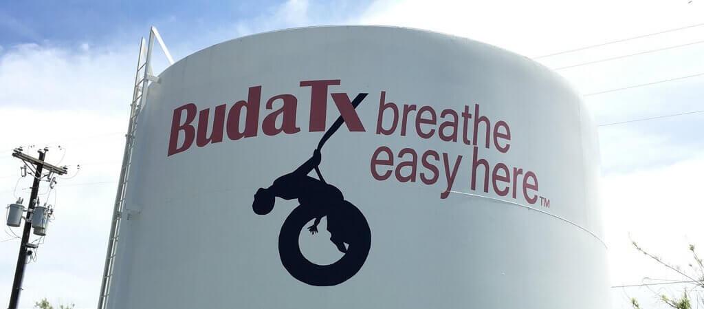 "Buda, Texas. ""Breathe easy here"" motto"