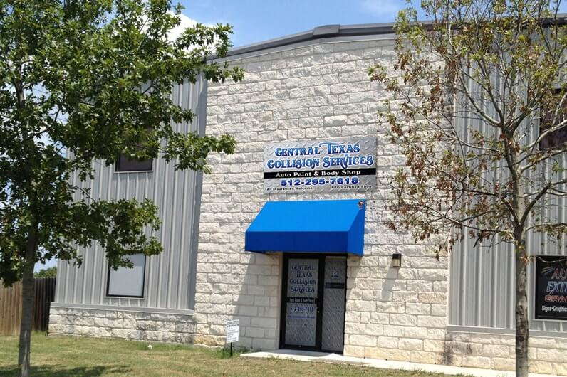 View from the outside of the Central Texas Collision Services office in Buda, Texas.